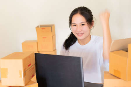 Young entrepreneur owns a teenage business. Are running their own business at home through the lifestyle that people now order Shop online even more, Concept social network, online shopping.