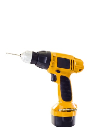 hand holding battery drill and drills wooden board, isolated