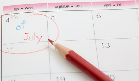 Closeup photo of pencil on calenda photo