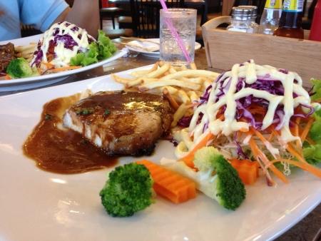 Steak pork and frenfrie salad Imagens