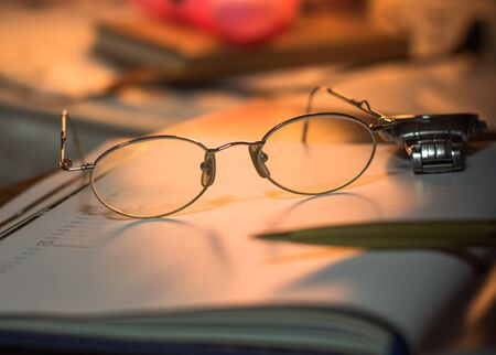 Still life of glasses on a book Imagens