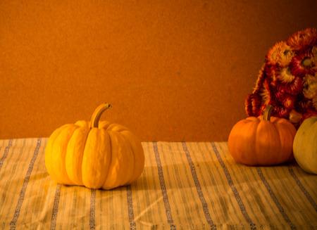 Tiny pumpkins and dry flower  on tabl stil llife