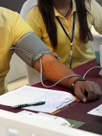 handcarves: measuring blood pressure Stock Photo
