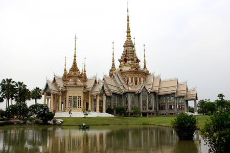 Thai Art White and golden Tample with lagoon photo