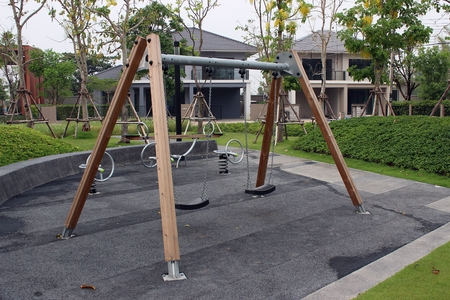 fenced in: Childrens playground with swings