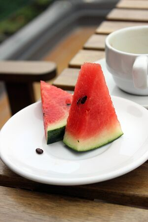 watermelon on a wooden background photo