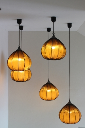 lampshades: Round stylish lampshades hang from ceiling