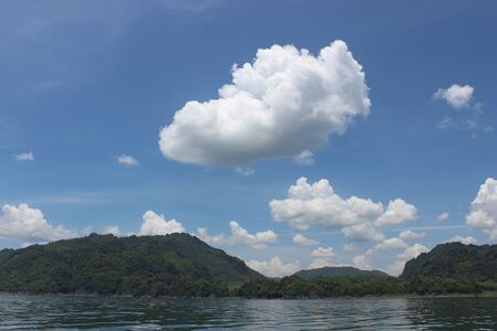Fluffy clouds in a blue sky of summer photo