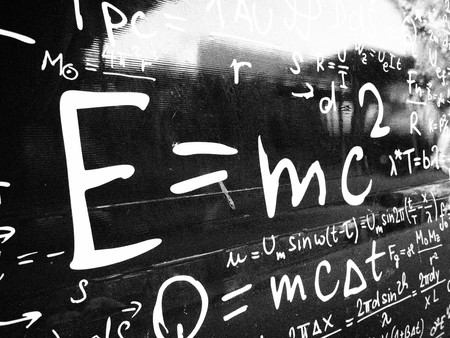 Emc2 formula on black wall.