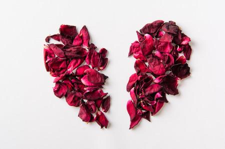 Dried rose petal, broken heart. Stock Photo