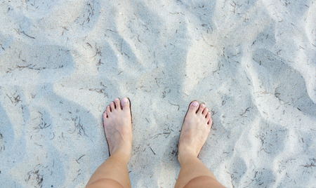 painted toenails: stand on color sand texture.