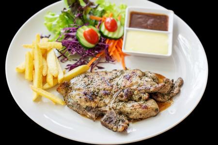 pork chop: Pork chop steak and french fries.