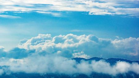 mountain ranges among the fog in the green season.
