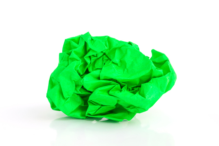 Crumpled green paper ball on a white background. Stock Photo