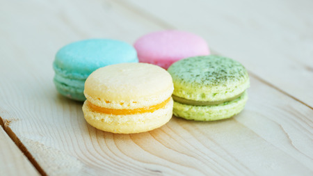 colorful cake macaron or macaroon on wooden background.