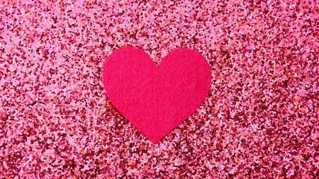 heart on a pink glitter abstracts for a background.
