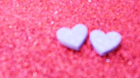 blur heart and pink bokeh abstract for a background. Stock Photo