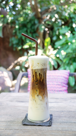 iced latte coffee on a wooden table.