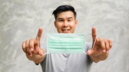 Asian man wears a protective mask. Archivio Fotografico