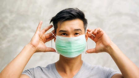 Asian man wears a protective mask. 스톡 콘텐츠