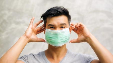 Asian man wears a protective mask. Standard-Bild