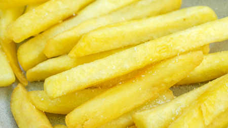 Close up of french fries on a table.