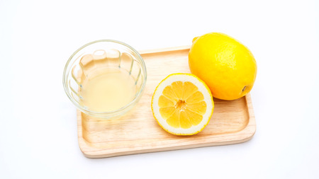 lemons on a wooden plate. Stock Photo