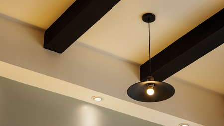 A lamp hanging on a ceiling.