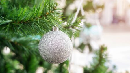 silver ball hanging on a Christmas tree.