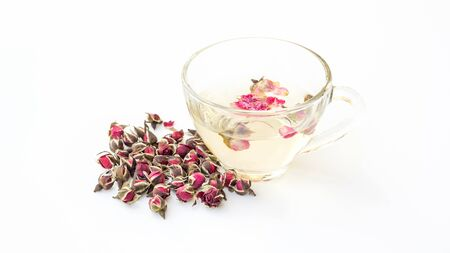 A cup of tea pink rose on a white background. Banque d'images - 132109781