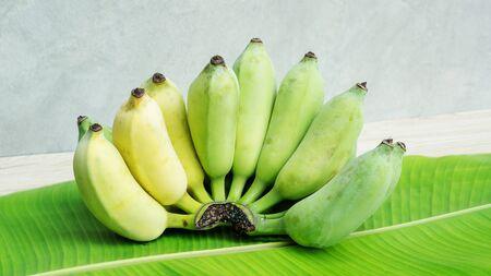 Pisang Awak banana on a banana leaf and wooden table.