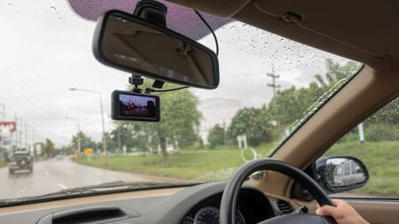Windshield has installed a car camera on a rainy day.