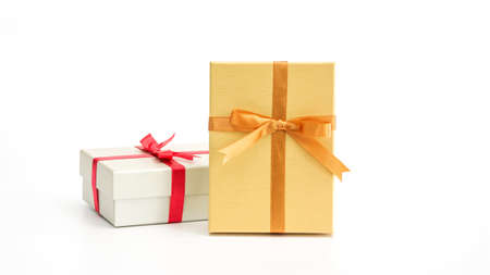Silver and gold gift box on a white background.