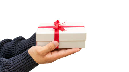 Man holding a silver gift box on a white background.