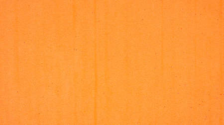 Close up of an orange sponge for a background.