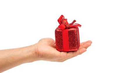 Man holding a red gift box on a white background. 免版税图像
