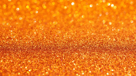 Orange glitter texture for background.