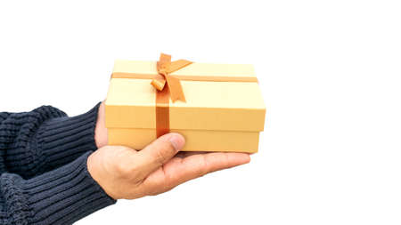 Man holding a gold gift box on a white background.