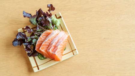 Fresh salmon sashimi on  wooden table. 免版税图像
