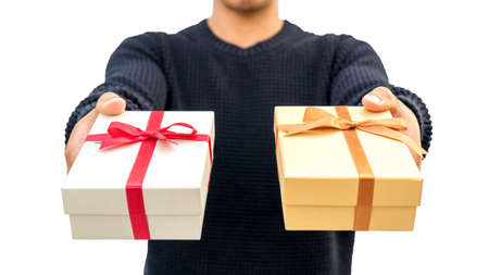 Man holding a gold and silver gift box on  white