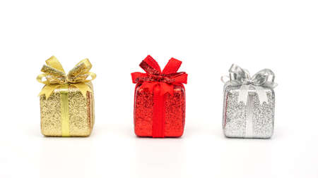 Gold, red, and silver gift box on a white background. 免版税图像