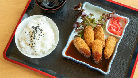 Deep fried chicken tenderloin with Japanese curry, rice, and soup.