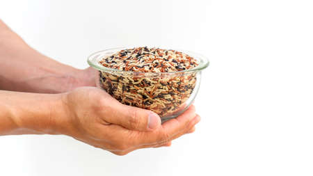 Man holding organic three colors (red, black, and brown) rice on a white background.