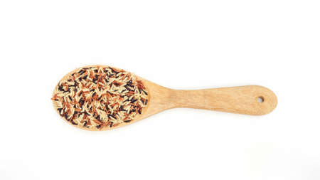 Organic three colors (red, black, and brown) parboiled rice on a white background. 免版税图像