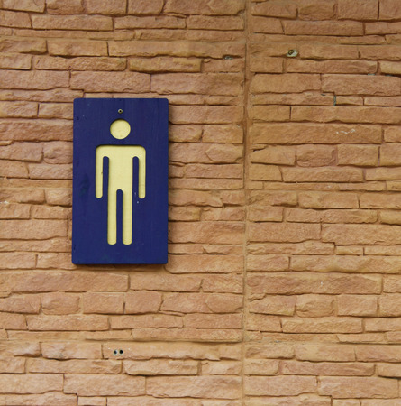 genders: The Sign of restroom on wall background Stock Photo
