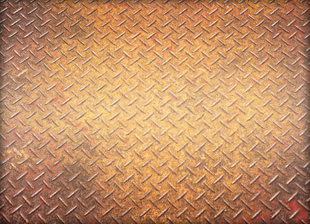 Background of old metal diamond plate in brown color. photo