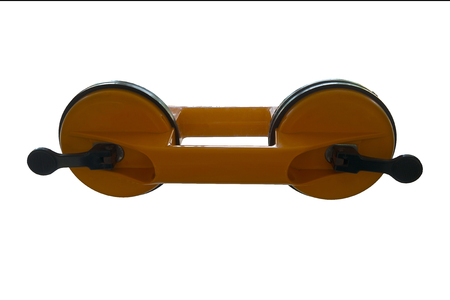 lift lock: Yellow Dual Cup Suction Lifter isolated on the glass