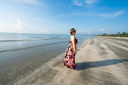 beautiful woman stand on the beach at sunny day and happy feel. soft focus