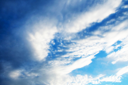 atmosphere: beautiful blue sky and cloud. subject is blurred.