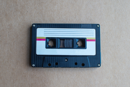retro of tape cassette on brown background. soft focus.